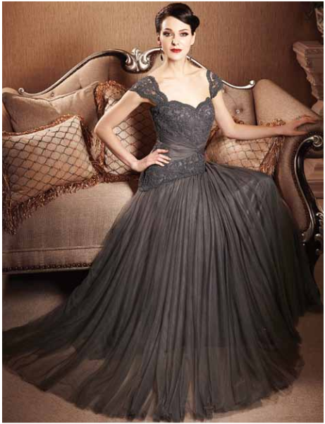 ab55743db3 T. Carolyn Fashions  Terrie Martin styles Brides    Grooms  Mothers to  Perfection.